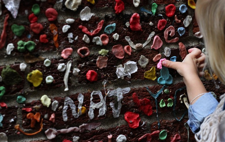 One more piece of gum is added to the estimated more than 750,000 pieces in Post Alley. The Gum Wall attraction in Post Alley with visitors to the covered brick, to be cleaned in a week. Tuesday Nov 3, 2015
